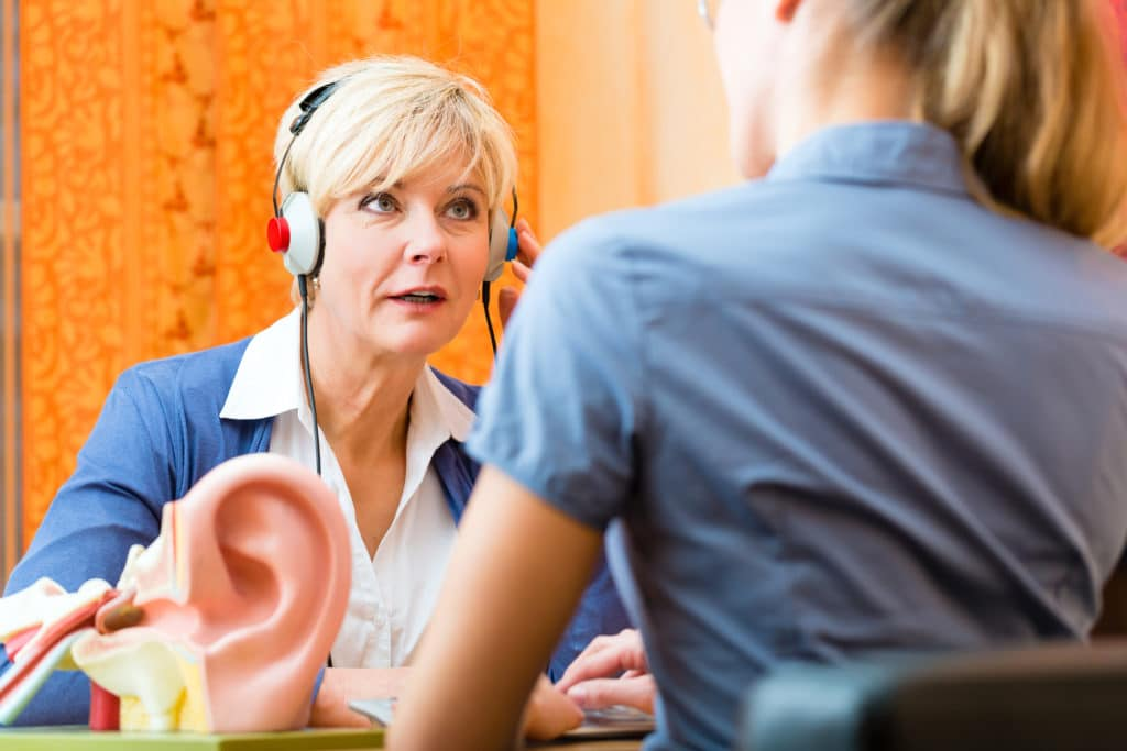 Hearing Dynamics audiologist conducts hearing test